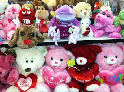 Store shelves lined with Valentine-themed stuffed animals