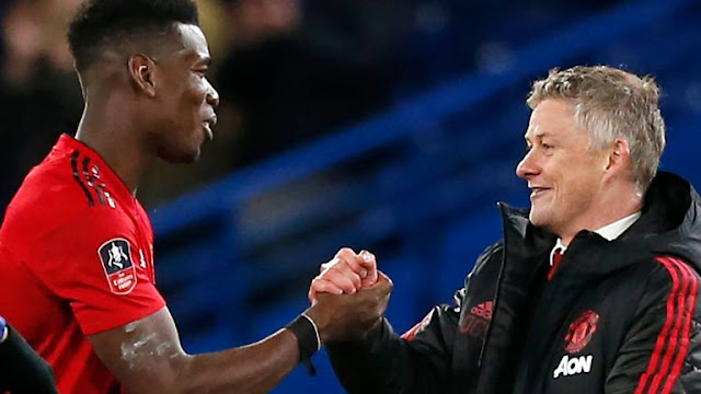 Manchester United Paul Pogba and Ole Gunnar Solskjaer