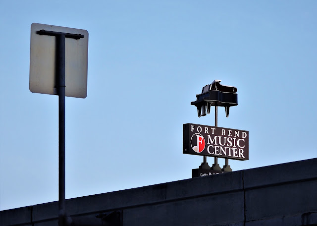 FORT BEND MUSIC CENTER PIANO FREEWAY SIGNAGE