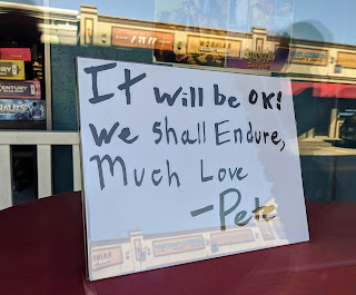 sign on the window at Pete's Emporium on Main St