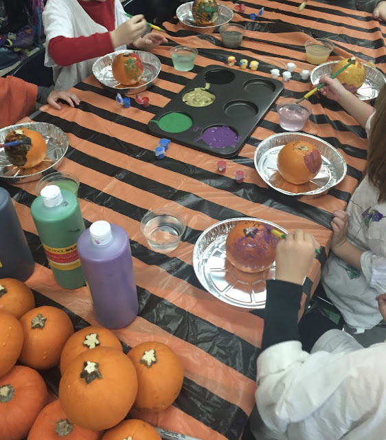 adding pumpkin painting to your art center for your kindergarten halloween party