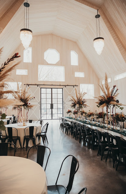 Fall Barn Wedding Reception with tall centerpieces and lanterns
