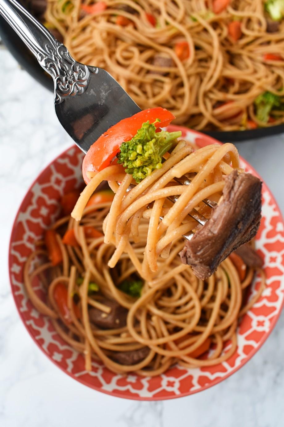 bite of steak stir fry noodles