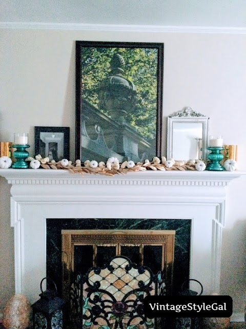 Added white candles to large teal candlesticks