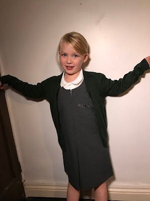 My daughter wearing Trutex bottle green cardigan, charcoal pinafore and white polo shirt