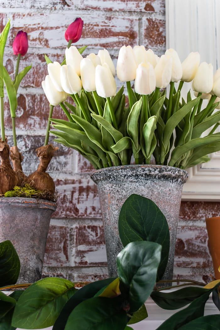 faux forced tulip bulbs in stone flower pots