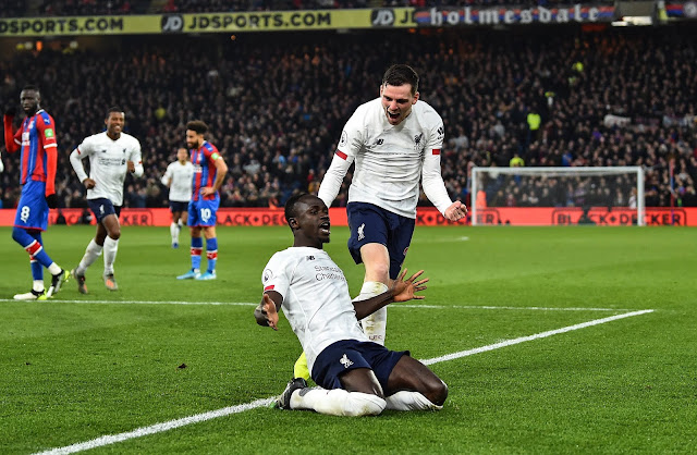 Sadio Mane and Andy Robertson celebrate goal against Crystal Palace in the Premier League