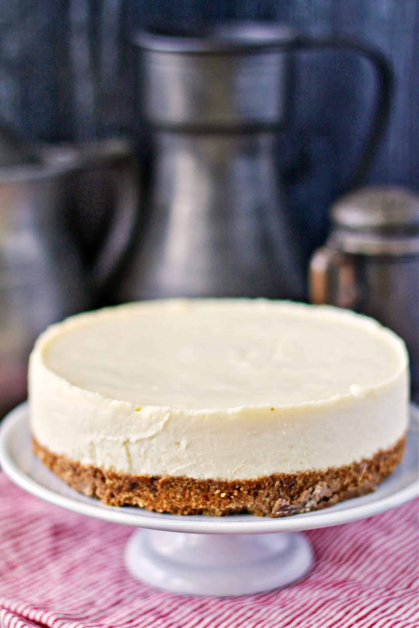Instant Pot Vanilla Cheesecake on a cake plate.