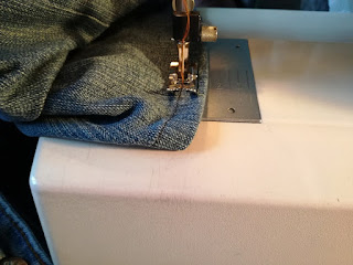 sew with color on edging of old jeans craftrebella