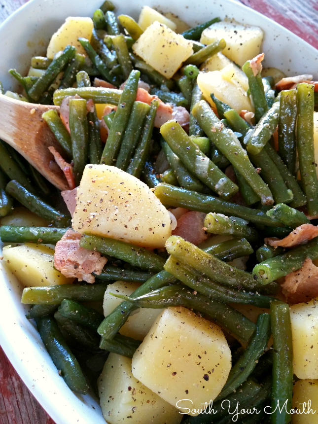 Cooking fresh green beans with bacon and onion