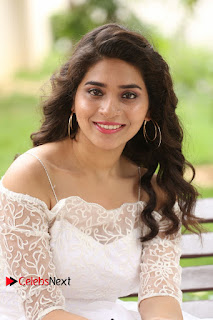 Actress Tejaswini Pictures in White Dress at Lachhi Teaser Launch  0094