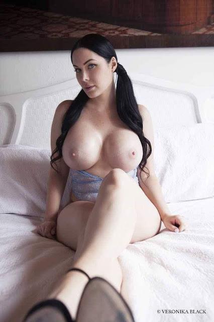 Veronika Black naked strip on bed