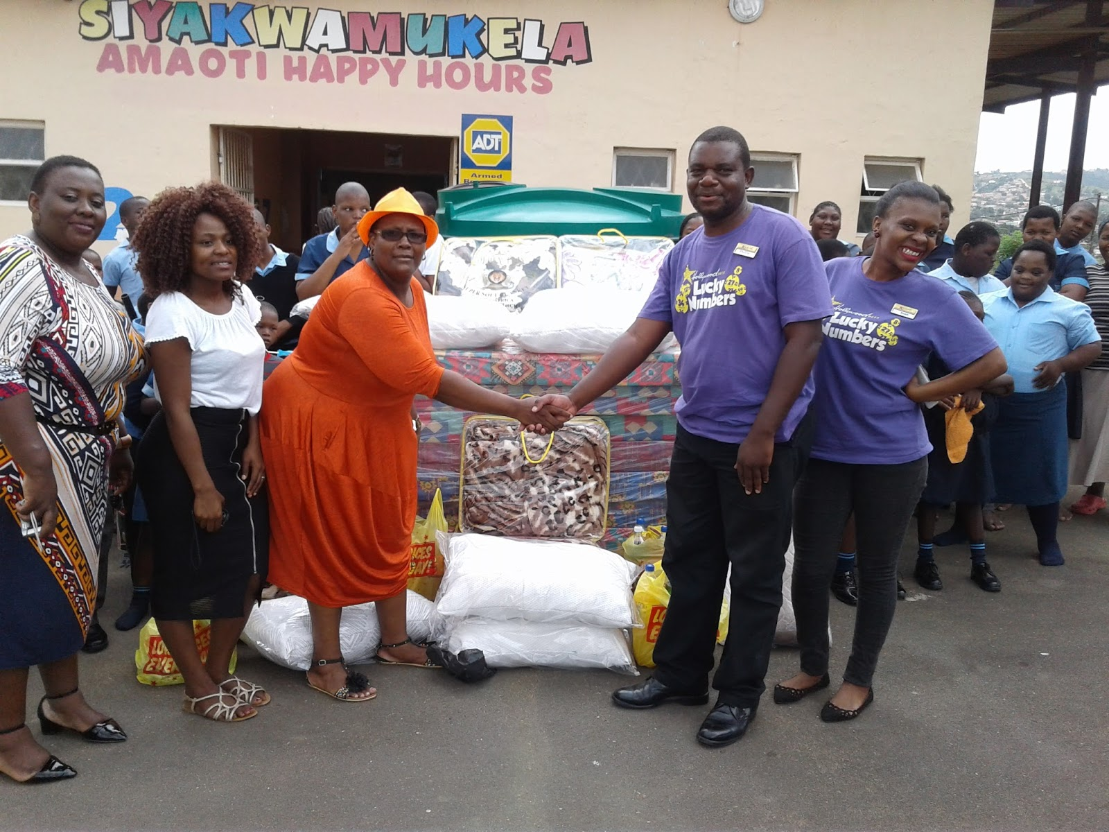 Staff at the Amaoti Happy Hours Day Care Centre are happy to receive support from Hollywoodbets Verulam