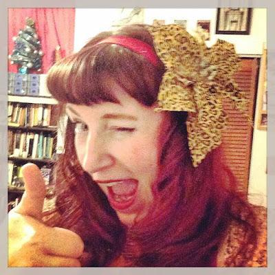Bridget Eileen sporting a Leopard Print Poinsettia from the Craft Store as a Hair Rosette