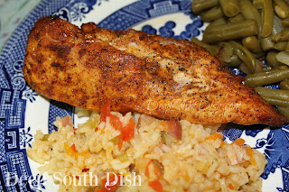Boneless chicken breasts, soaked in a southwestern seasoned, brown sugar brine, tossed in fajita seasonings, grilled over indirect heat and served with a southwestern seasoned rice.