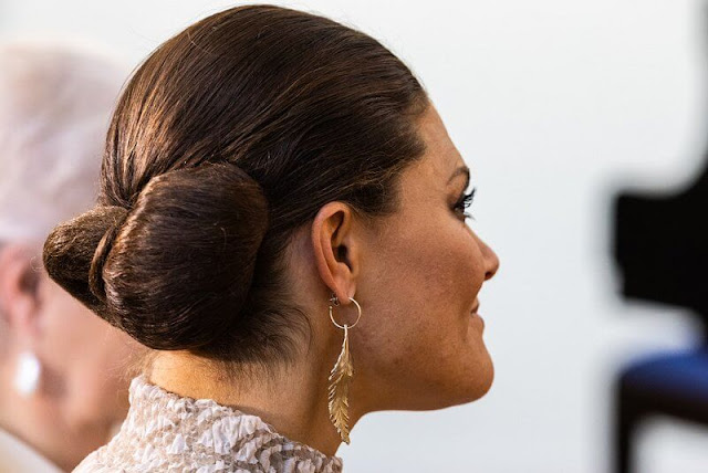 Crown Princess Victoria wore a new leaf patterned midi dress by Valerie. Princess Christina. Kreuger Jewellery feather earrings
