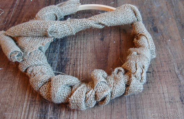 Burlap and flannel join together to make a perfect Christmas Wreath. - Littlehouseoffour.com