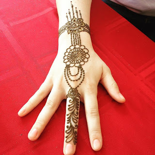 henna mehndi body art with paste on skin on red background jewelry style mehndi