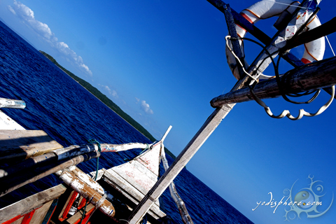 Island hopping, Philippine motorized banca sailing in blue sea
