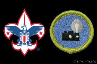 Graphic of the Boy Scouts of America Logo with the Photography Merit Badge on a black background