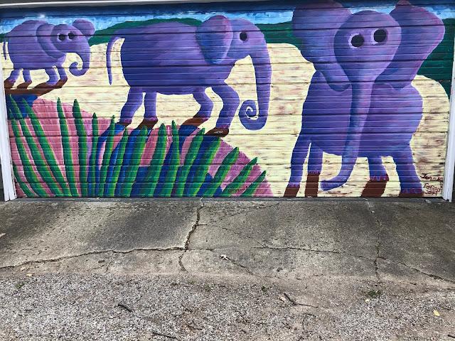 Elephants cheerfully wandering along. Mural by artist Teresa Parod.