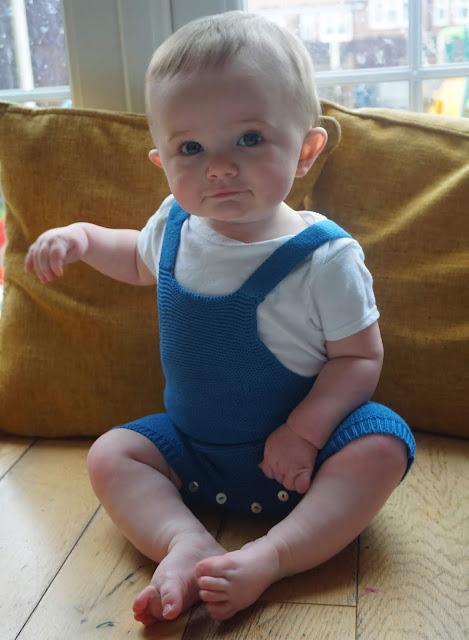 baby wearing a blue and white outfit