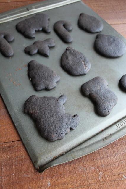 black cookies cut into fun shapes on sheet pan