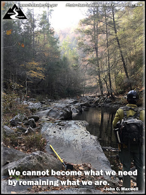 We cannot become what we need by remaining what we are. – John C. Maxwell (Wildland firefighter near a pond and waterfall)