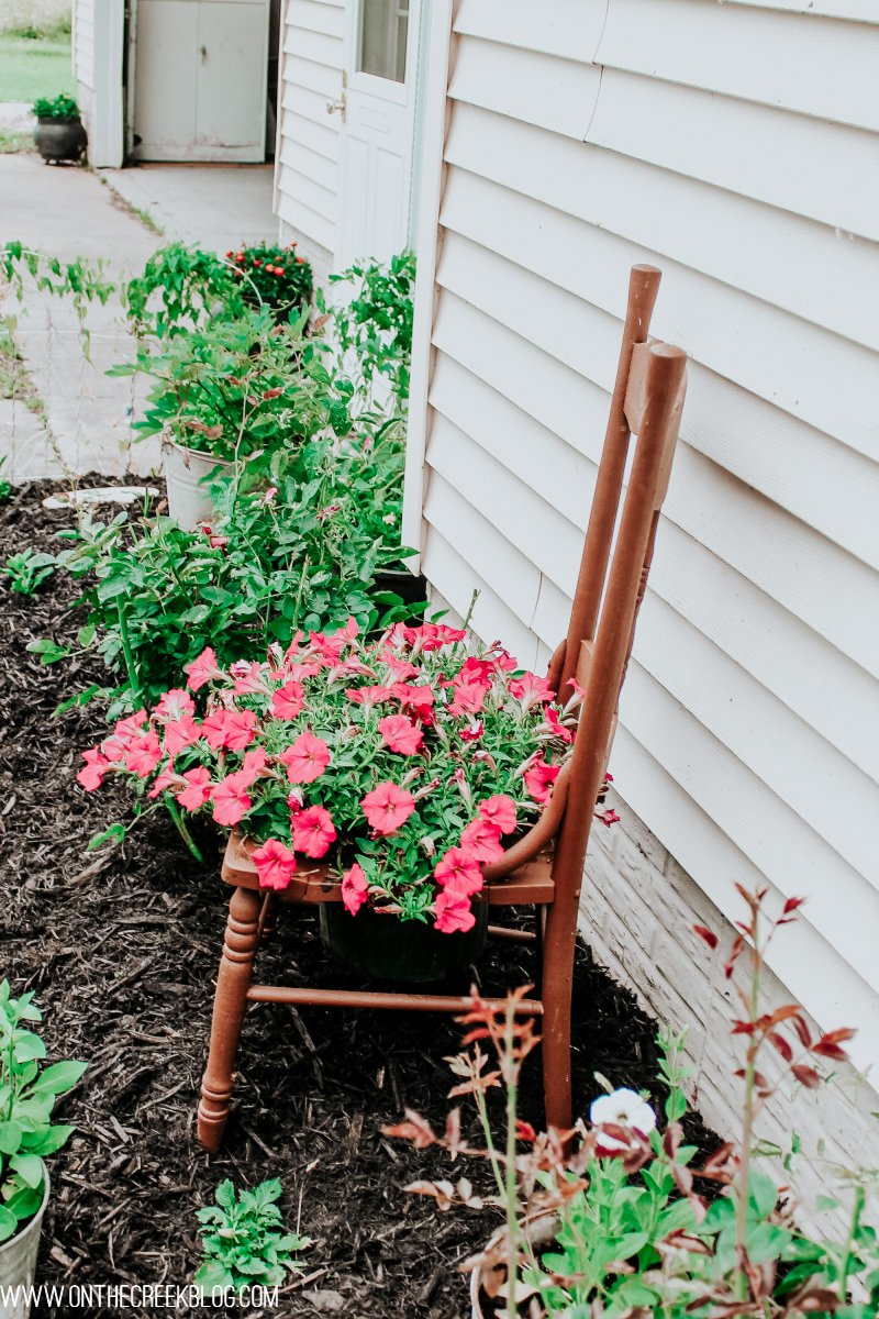 Flower chair planter idea.  Overflowing flowers in the chair seat!