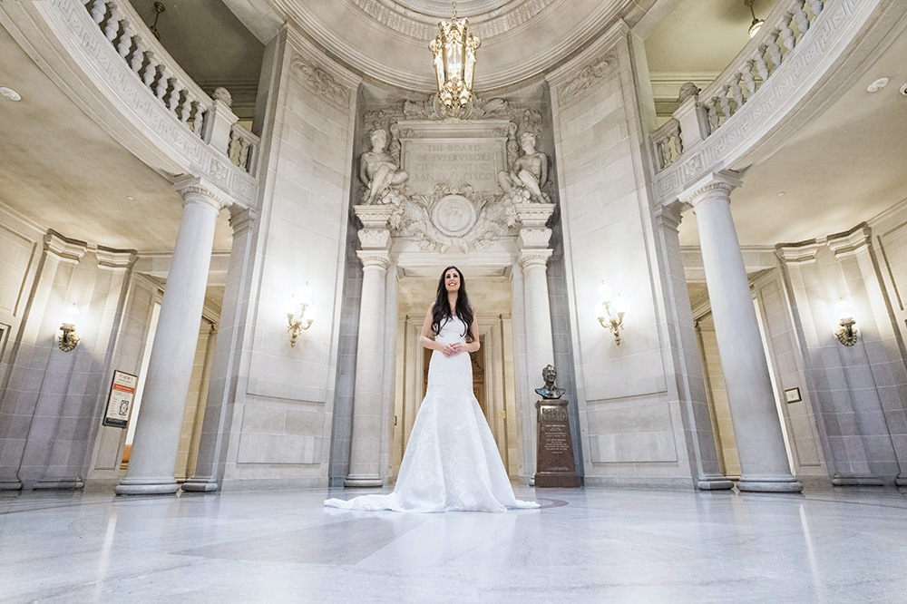 Bride standing in San Francisco City Hall
