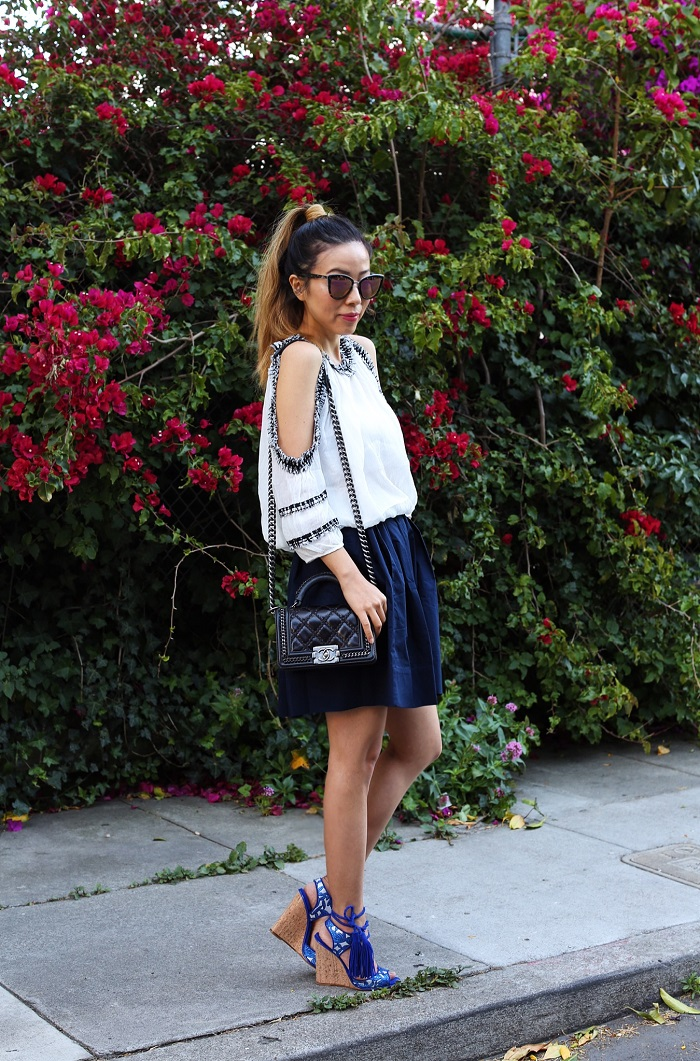 She in cutout shoulder top, everlane pleated shirt, paul andrew tassel wedge sandals, quay sunglasses, chanel boy bag, summer outfit, tassel wedge sandals
