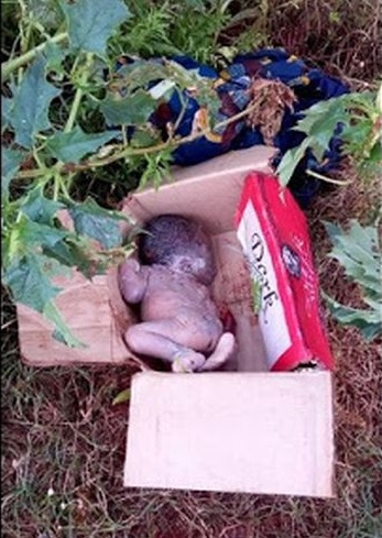 Heartless Mother Dumps Day-Old Baby In Carton At Jos Market; See Photo