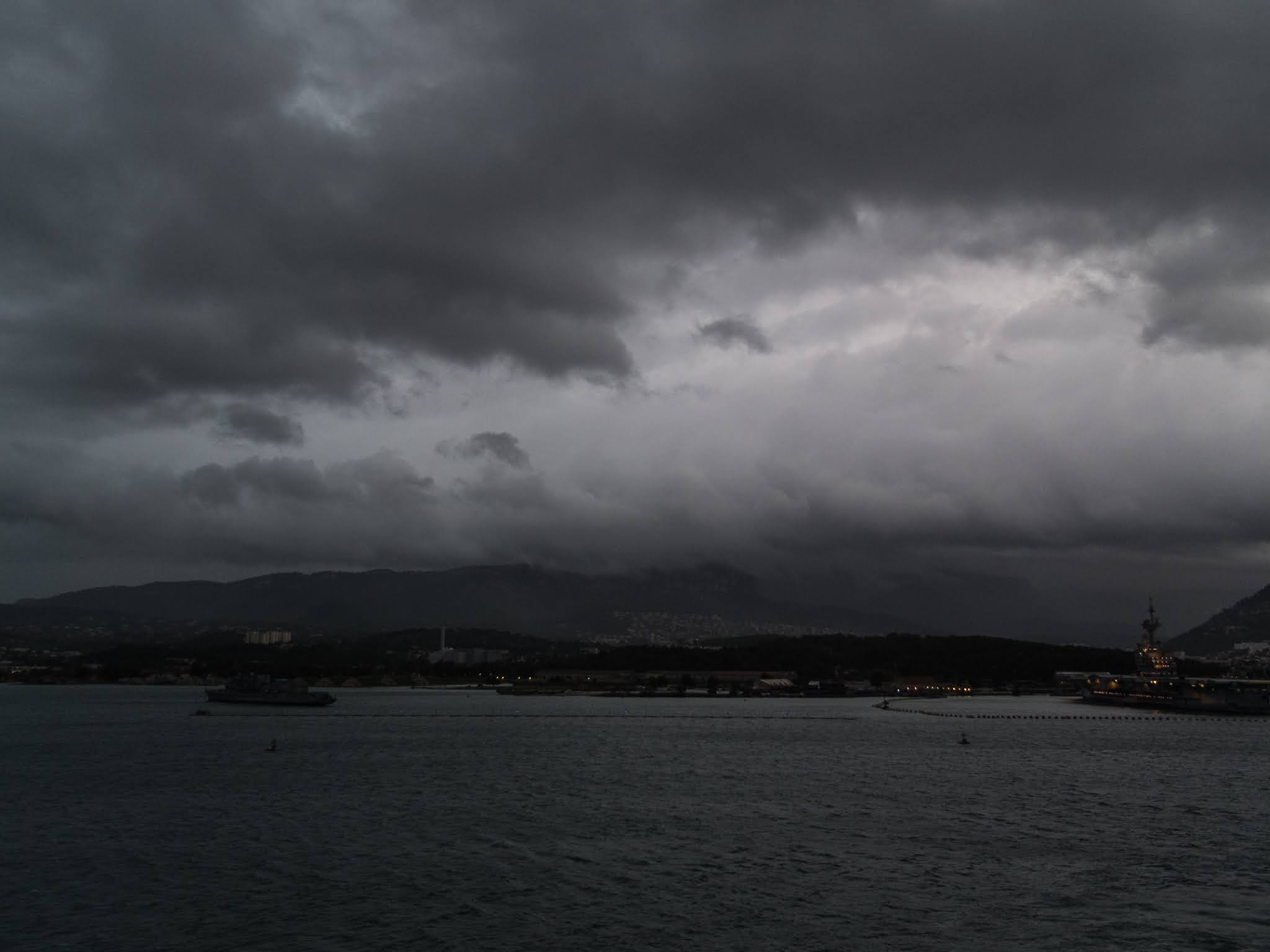 Dark clouds in Toulon harbour on an early autumn morning.