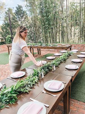 Jen Hosler setting up tables at Casa Feliz