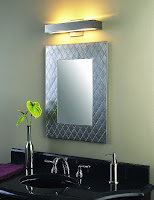 Modern wall sconce light for vanity lighting over the framed mirror