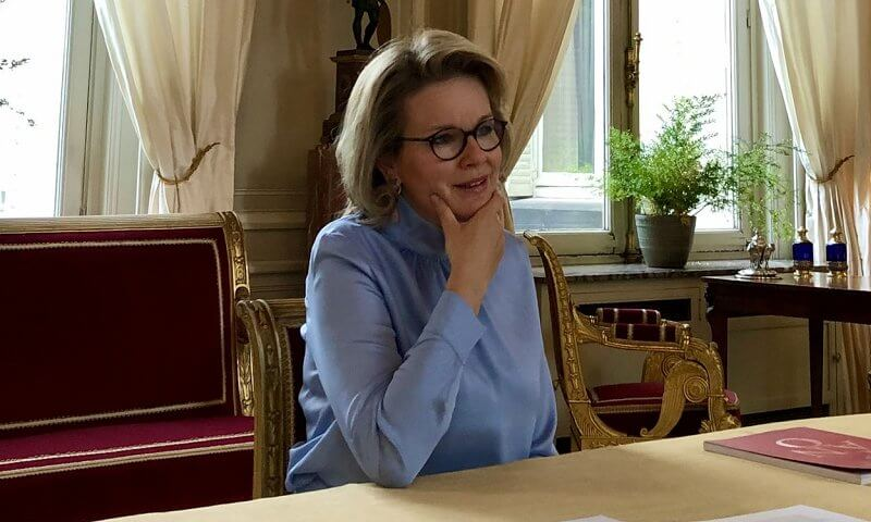 Queen Mathilde wore a sky blue tie-bow silk blouse from Natan Fall Winter 2020 collection, and sky blue trousers from Natan