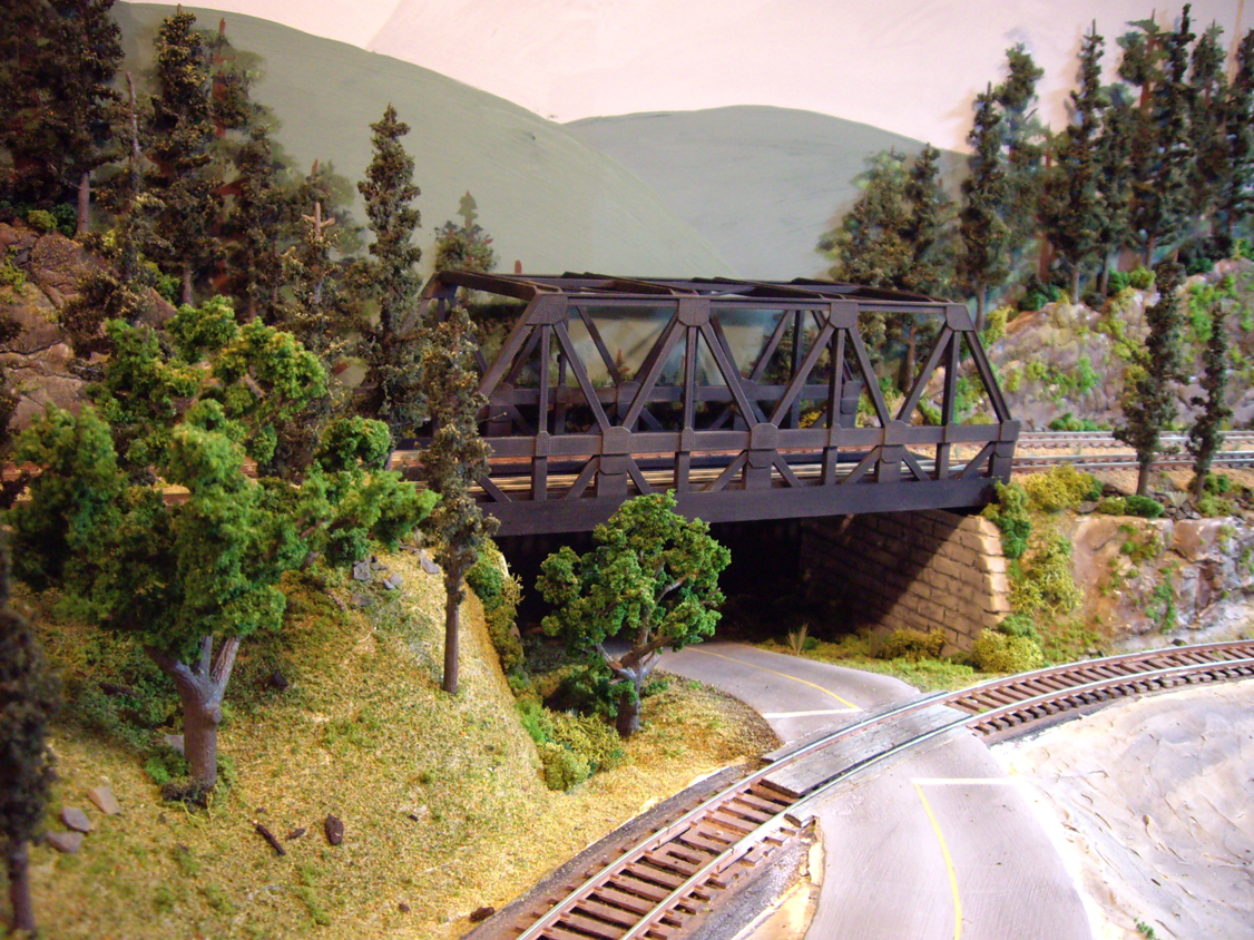 Upgraded double wide warren-truss train bridge with forest scenery, bridge abutments and grade crossings