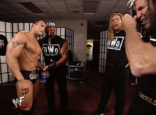 WWE / WWF No Way Out 2002 - The Rock poses for a photo with the New World Order