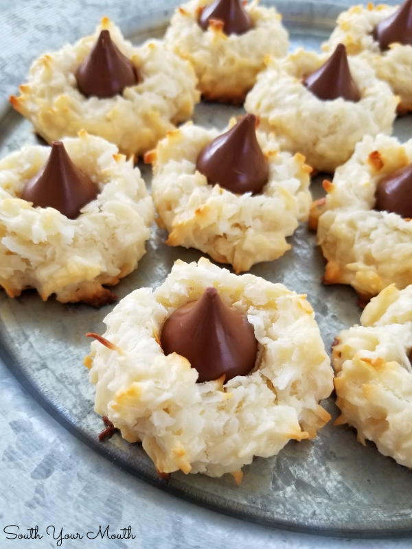Coconut Macaroon Kisses! A tender and light, yet rich and dreamy recipe for chewy coconut cookies topped with Hershey's Kiss chocolate drops.