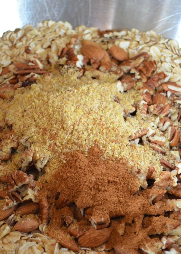 Healthy Granola Recipe stir together rolled oats, almonds, pecans, flax seed, and cinnamon from Serena Bakes Simply From Scratch.