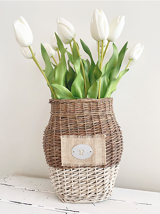 basket with white bottom and white tulips