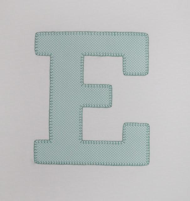 camiseta inicial E