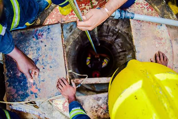 Photos: Man accidentally falls into well in Lagos