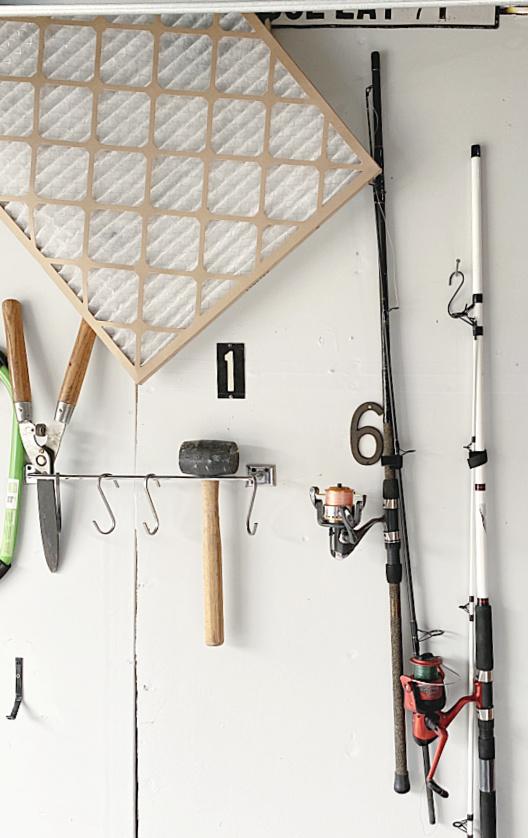 tools and fishing pole organization