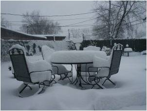 Patio furniture set covered with snow