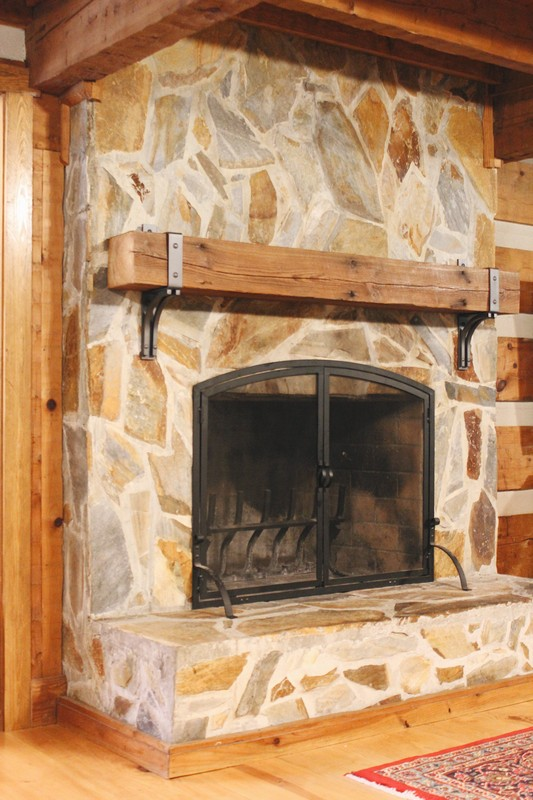 stone-fireplace-antique-reclaimed-rustic-beam-mantel-steel-bracket-log-cabin