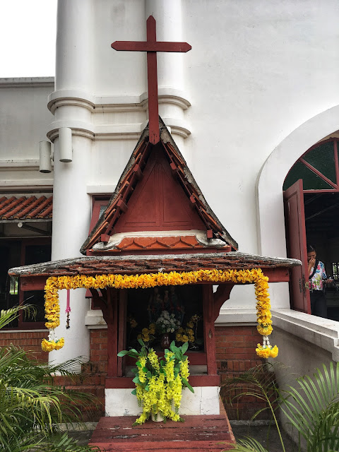 a Christian spirit house in the Thai style