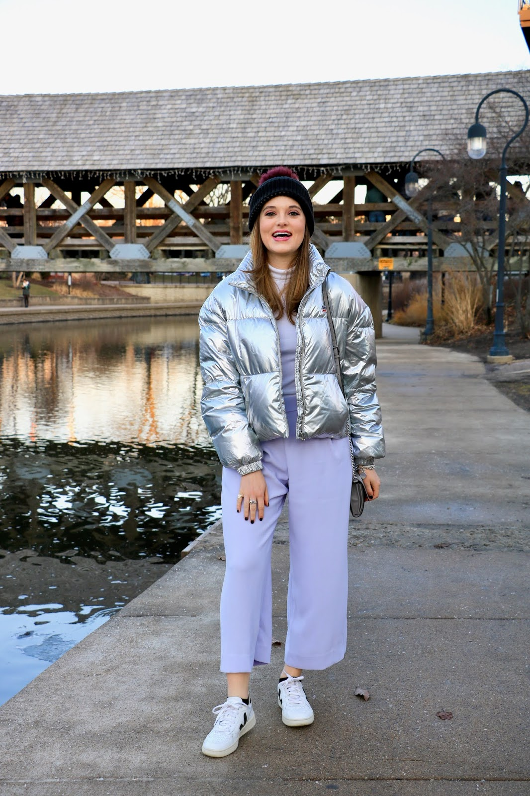 Nyc fashion blogger Kathleen Harper wearing a silver puffer coat outfit.
