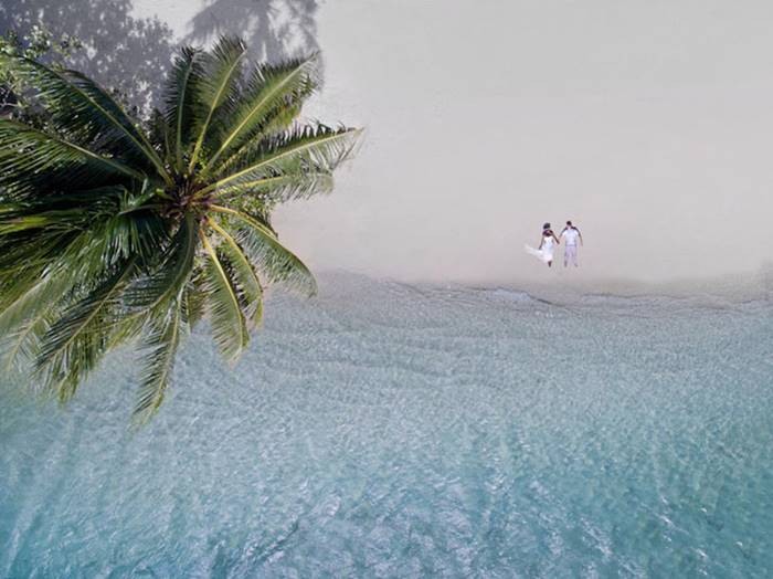 Photographer Helen Avar lives in Tahiti and uses drones with cameras to take unusual wedding photos.