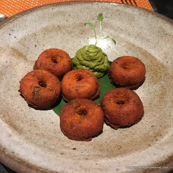 tiny ricotta and black bean vada--light as a beignet, and served with curry leaf chutney at Campton Place Restaurant in San Francisco, California